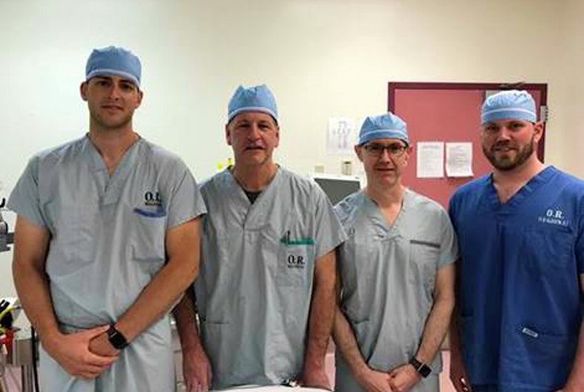 Registered nurse first assistants Jeff Hardy (left) and Matthew Rizzato (right) with clinical preceptors, Dr. Don Brien, orthopedic surgeon (second from left) and Dr. Rod McGory, site lead for surgery at Cape Breton Regional Hospital (second from right).
