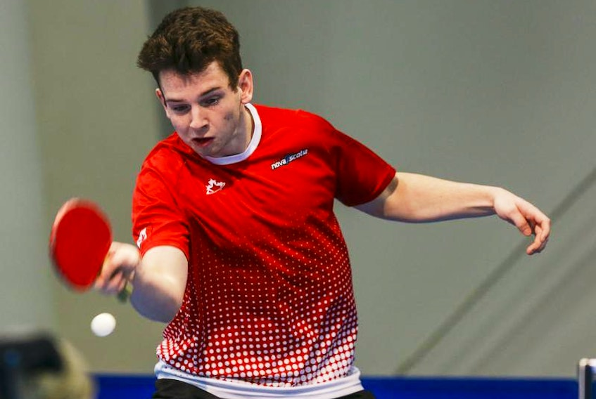 Dartmouth's Liam Caron competes in table tennis action at the Canada Winter Games in Red Deer, Alta., on Monday. Caron won two matches on Monday.