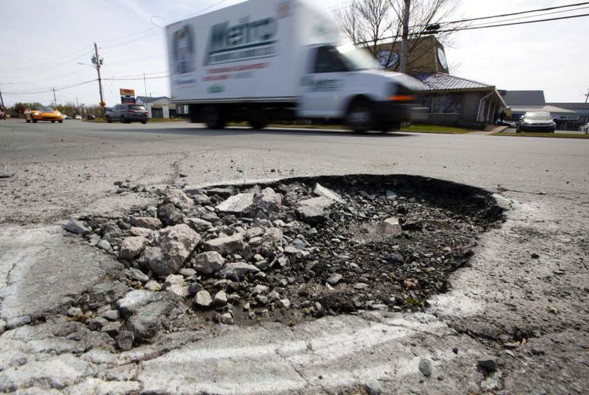 A large pothole remains untouched on Eisener Boulevard in Dartmouth Tuesday. The pothole was spray painted back in March, but city crews have yet to repair the hole in the road.