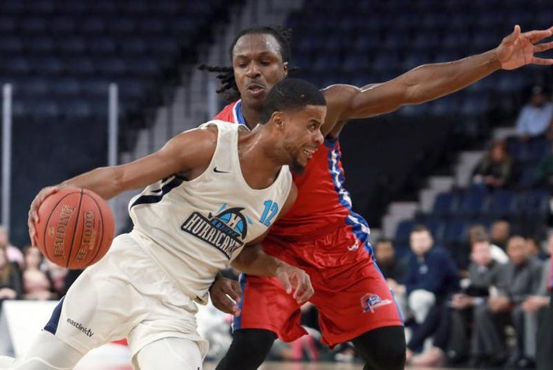 Halifax Hurricanes' Cliff Clinkscales powers through the defence from Cape Breton Highlanders' Charles Strowbridge during an April 13 game at Scotiabank Centre. - Eric Wynne