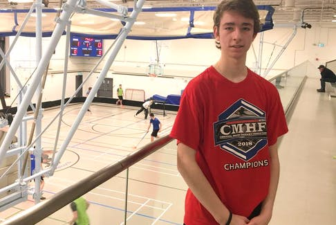 Daniel Henri of Port Williams stands in the balcony of the Wolfville School gym as a floorball game takes place below. Henri is one of four Nova Scotians on the under-19 Team Canada floorball team.