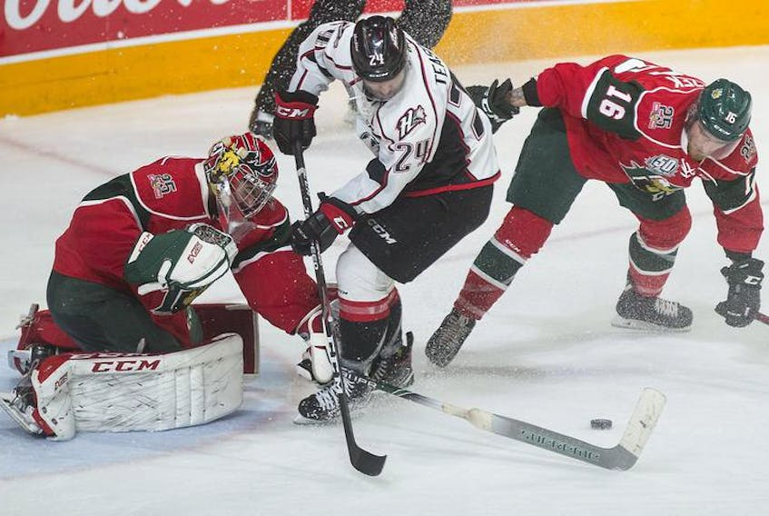 Halifax Mooseheads goalie Alexis Gravel pokechecks Rouyn-Noranda Huskies forward Joel Teasdale during the third period of Saturday's QMJHL final game at the Scotiabank Centre.