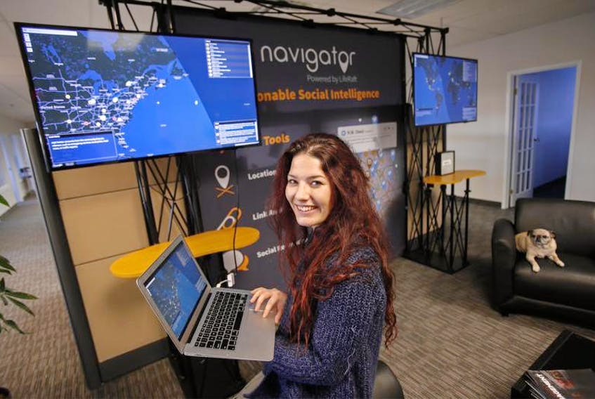 Melissa Cooper, marketing and communications manager with LifeRaft Inc., is seen in the company's Bayers Lake office in Halifax on Friday. The company uses AI to monitor threats to clients that occur on the internet.