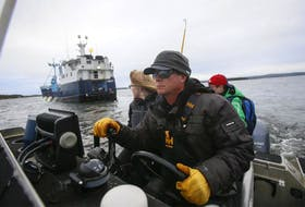 Chris Fischer, expedition leader of the M/V Ocearch pulls up to the vessel off Mosher's Island, near Riverport, on Tuesday.