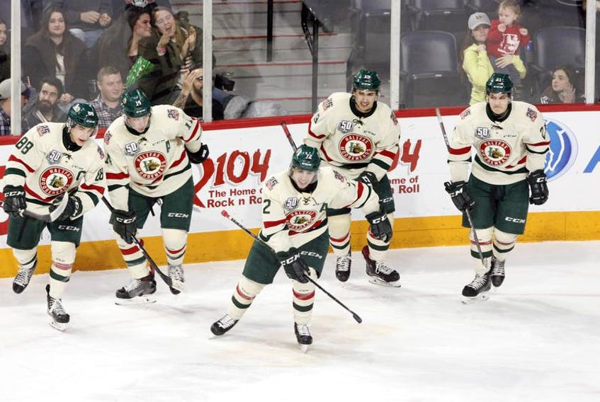 Halifax Mooseheads Samuel Asselin, centre, and Antoine Morand, left, won the 2018 Memorial Cup with the Bathurst Titan.