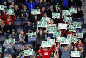 Halifax Mooseheads fans at a Feb. 24 game against the Gatineau Olympiques hold up signs at the Scotiabank Centre.