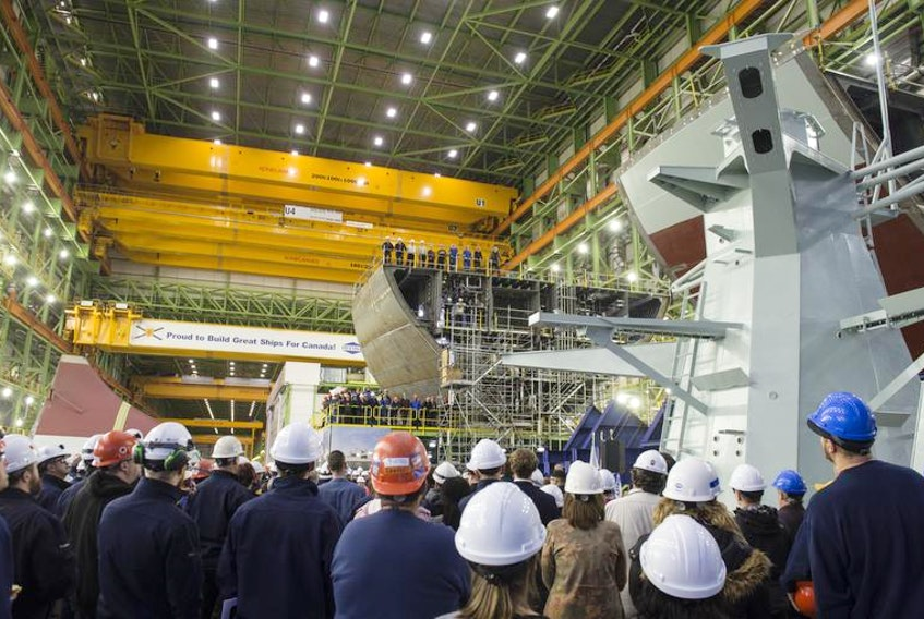 Shipbuilders are shown wait for a federal government announcement at Irving's Assembly Hall. The shipyard has been a big employer in Halifax.