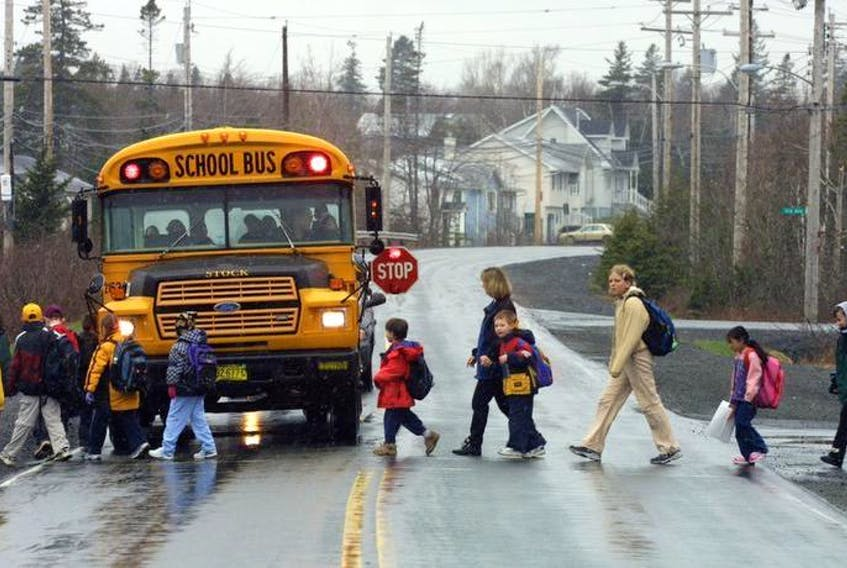 A school bus stops for students in this file photo.