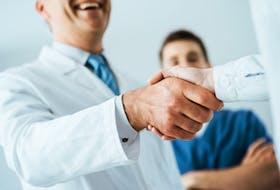 Stock photo of doctors shaking hands.