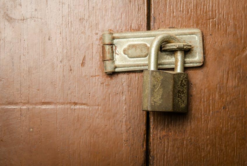 A door locked by padlock.