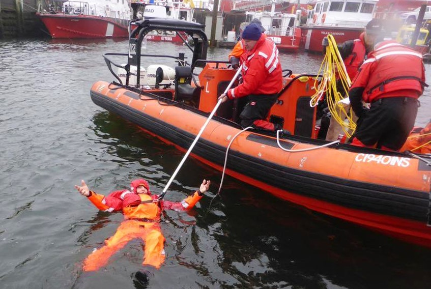 Scientist Paul Brodie is shown testing what he calls a one-of-of-a-kind PFD in the Bedford Basin recently. Made of innovative, light-weight material, the survival suit offers fishermen a much-needed alternative to conventional PFDs, says Brodie.