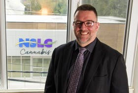 Psychologist Simon Sherry poses for a photo on Tuesday at his downtown Halifax practice that overlooks the new NSLC Cannabis location on Clyde Street.