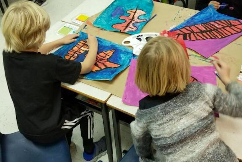 Children at St Thomas school in Halifax work on art during a class in October.