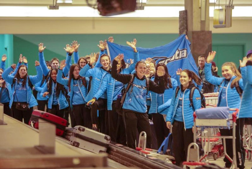 Team Nova Scotia athletes wait for their luggage at the Calgary International Airport on Thursday. The athletes were then taken by bus to Red Deer, the host of the Canada Winter Games that begin on Friday with the opening ceremony. Competition begins on Saturday.