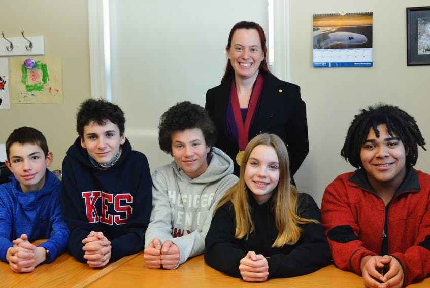 Governor-General's Award-winning Booker School teacher Temma Frecker with former students, Forrest Robinson, Henry Mulherin, Colin Stephens, Hana Hutchinson and Will Mercer, who last year developed a proposal on how to handle the controversial Cornwallis Statue in Halifax. Not pictured is student Abby Welton.