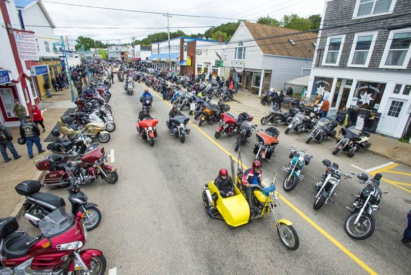 Motorcyclists drive down the main street of Digby during the Wharf Rat Rally in 2017.