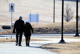 March 23, 2020–A elderly couple walk hand-in-hand along the sidewalk surrounding the Halifax Common Monday morning.