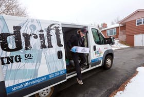 Noah Fournier from Spindrift Brewing makes a delivery to a home in Cole Harbour on March 27, 2020.