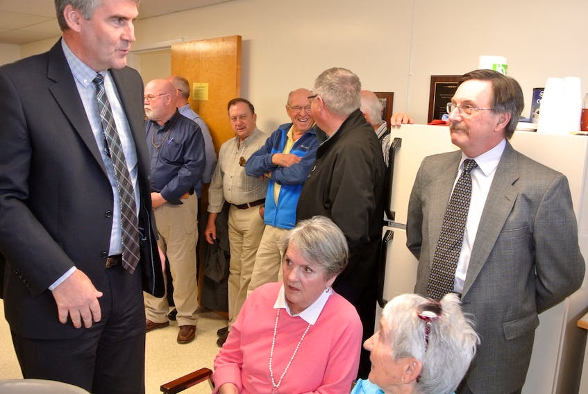 Premier Stephen McNeil speaks to Dr. Brian MacFarlane and Pugwash residents last April after announcing design tenders would be called that summer for a new health-care facility in the village. Residents voiced their concerns about the construction schedule and frequent ER closures at North Cumberland Memorial Hospital during a public meeting on Sunday.