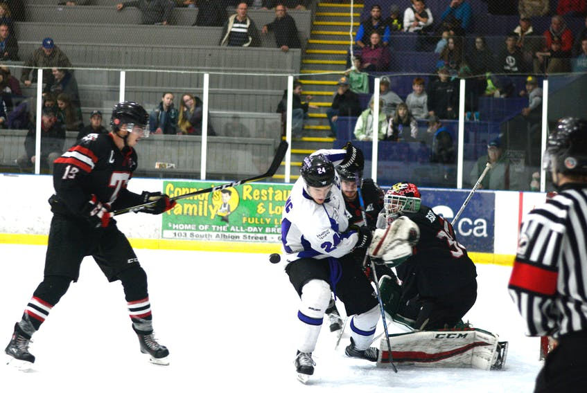 Jordan King swept behind the Bearcats defence and nearly scored on this shot during overtime action Saturday night at Amherst Stadium. King is in third place on the Maritime Hockey League's point-board with 18 points, six goals and 12 assists.