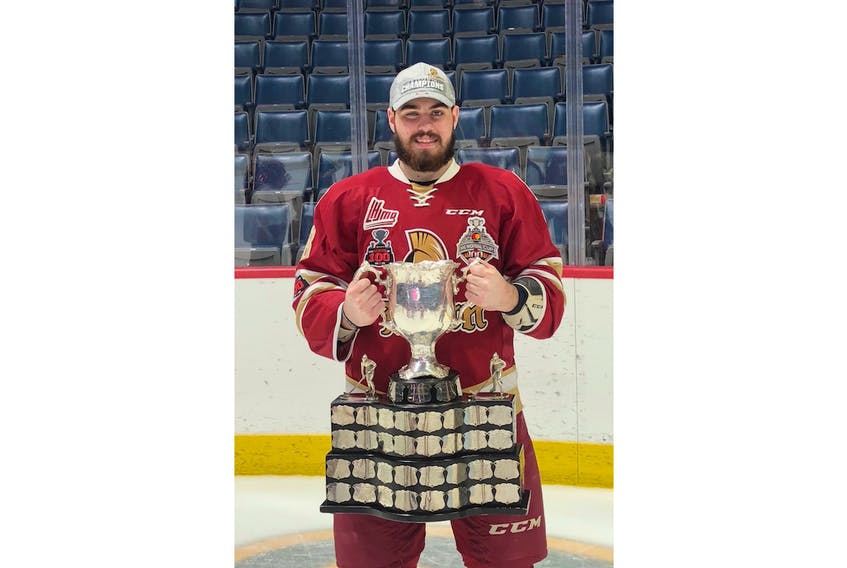 Zachary Bennett holds the top prize in Canadian junior hockey, the Memorial Cup.