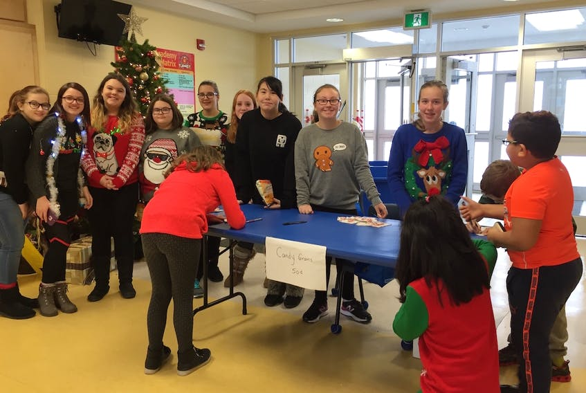 Members of Carbonear Academy's Student Leadership team were recently selling candy grams to raise money for a local food bank.