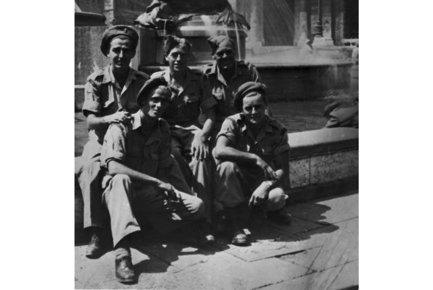 Eric Wood, top row at the left, with fellow members of the 166th Royal Artillery. He joined the artillery in 1941. — Submitted photo