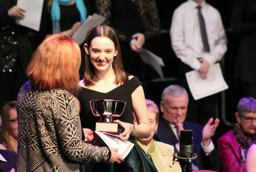 Anna Mercer being presented with the 2017 Junior Rose Bowl award.