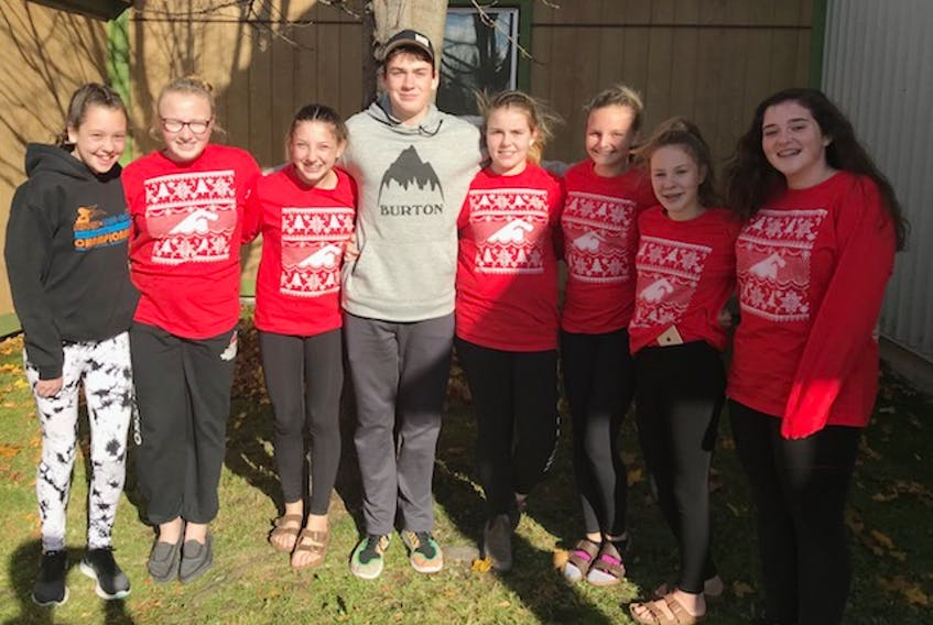 The eight swimmers who represented the Poseidon Swim Club at the Gander Toyota Fall Invitational (l-r): Sarah Burt, Ciara O'Keefe, Rylee Moores, Noah Coombs, Jorja Bennett, Abby Trask, Mackenzie Sutton and Megan Smith. — Submitted photo