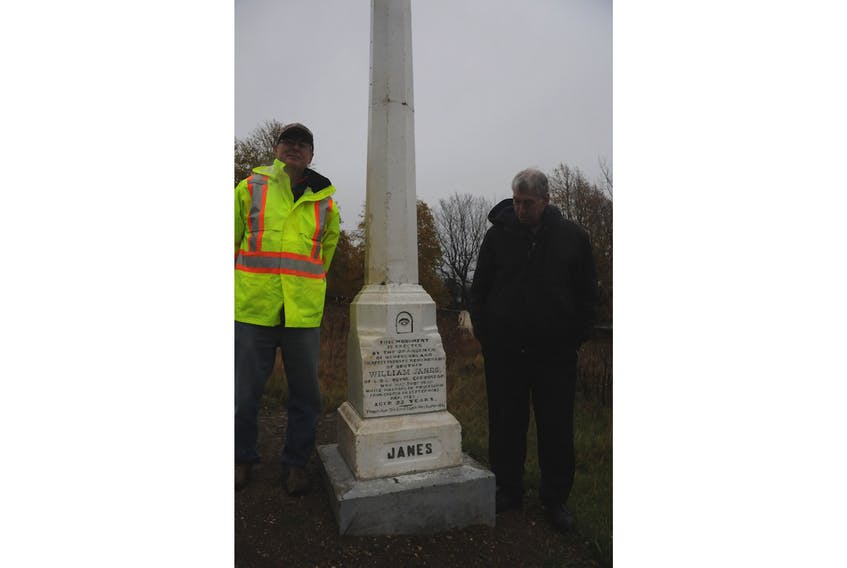 Duncan Howell, people's warden for St. James Anglican Church, left, and Bert Parsons of the Carbonear Heritage Society stand beside a monument dedicated to one of the most tragic events in Carbonear and Harbour Grace's shared history. — Andrew Robinson/The Compass