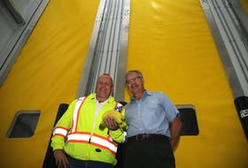 From the left, Atlantic Grocery Distributors quality assurance manager Bill Hunt and company president and CEO Dave Powell stand in front of the new banana ripening rooms.