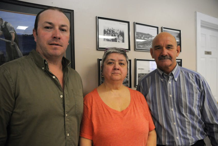 From left, are three members of a committee working to establish the first war memorial in Freshwater, Conception Bay — Darryl Parsons, chairwoman Lynne Priddle and treasurer David Moriarity.