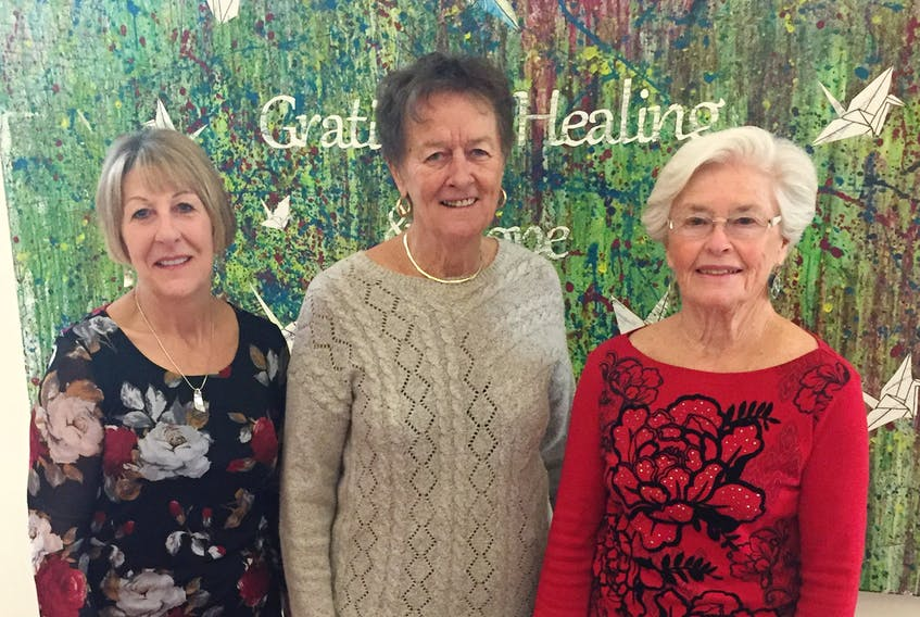 St. Martha's Regional Hospital Auxiliary members Nancy MacEachern (left), Yvonne Gallant and Marius Langley will be among the volunteers welcoming visitors to the group's annual Jingle Bell Frolic fundraiser Friday, Nov. 29. Corey LeBlanc