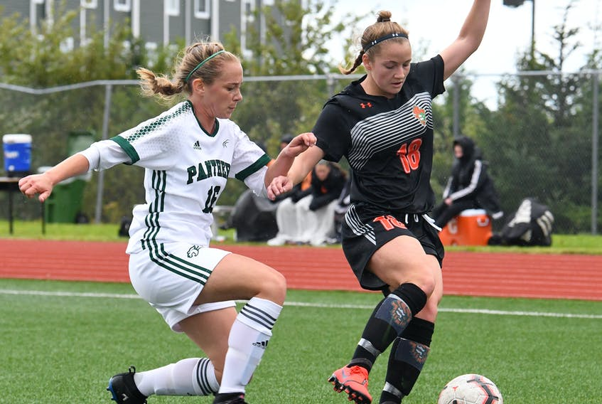 Antigonish native Rebecca Lambke of the Cape Breton Capers shields the ball from Olivia Cummings of the UPEI Panthers in Atlantic University Sport (AUS) action this season. CONTRIBUTED BY VAUGHAN MERCHANT