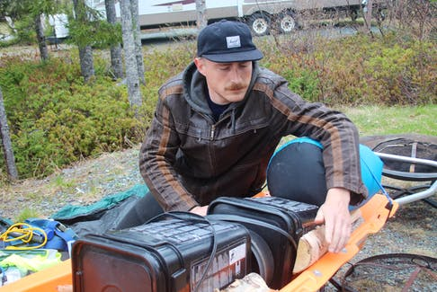 Neil Hamilton, of Peterborough Ont., is on a cross-country trek to raise awareness about Post-Traumatic Stress Disorder (PTSD) and mental health issues. The 28-year-old started the Newfoundland and Labrador section of his journey in St. John's over the Easter weekend, late April. He is pictured loading his cart as he prepares to depart Gander, May 28.
