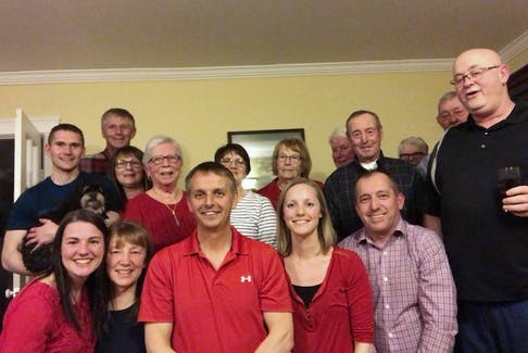 MHA elect Derrick Bragg, surrounded by supporters celebrates his re-election to the Fogo Island-Cape Freels district
