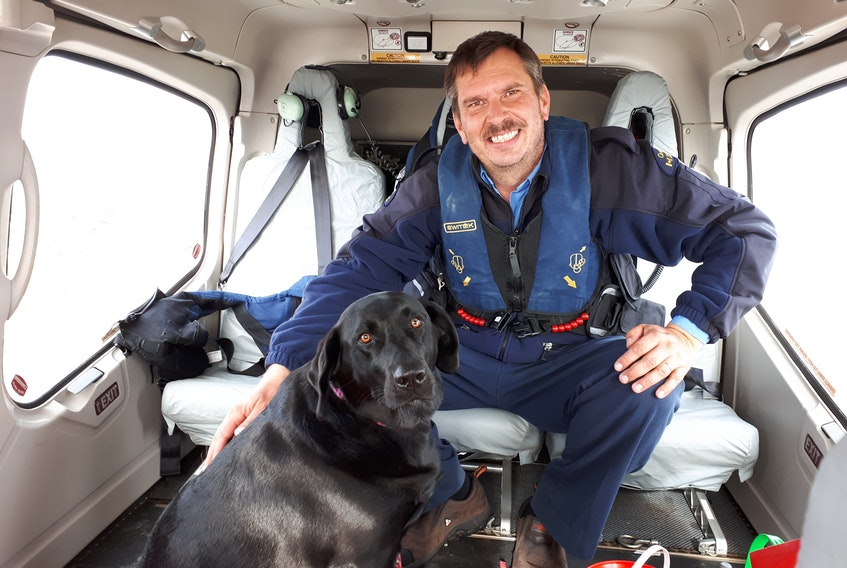 After a 28-day stint, principal lightkeeper Craig Burry and Molly, his three-year-old black Labrador retriever, head home to Wesleyville to spend time with family.