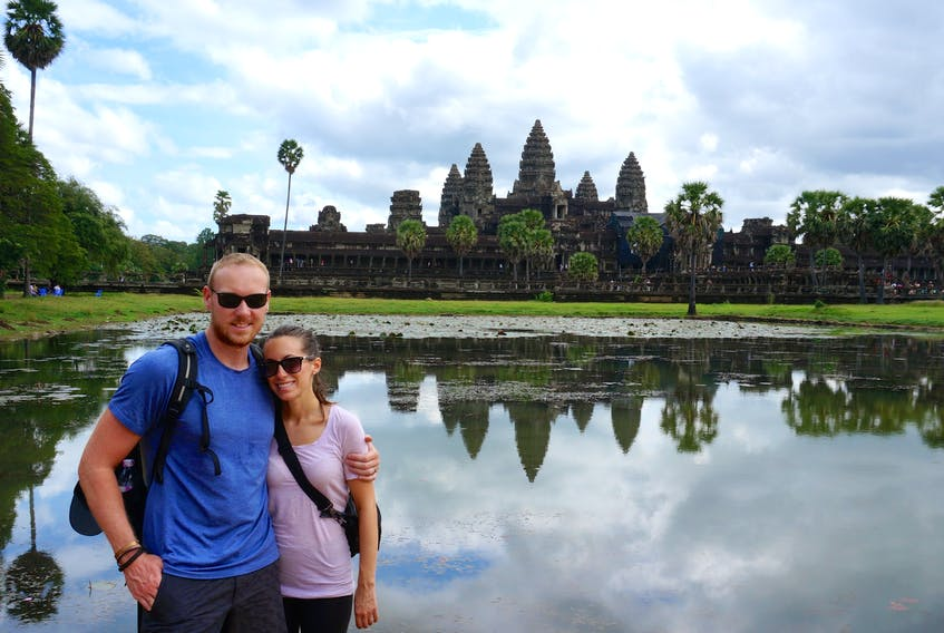 Steven (left) and Jess Trickett pose for a picture outside Angkor Wat in Siem Reap, northern Cambodia. The pair took a year off from their North American routine to travel the world.