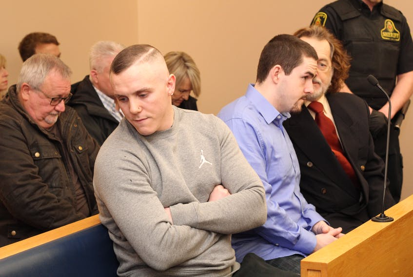Calvin Kenny (left) leans away as Chesley Lucas speaks with his lawyer Bob Buckingham. The pair were sentenced 12 years and six months in prison in relation to the stabbing death of Steven Miller in 2016.