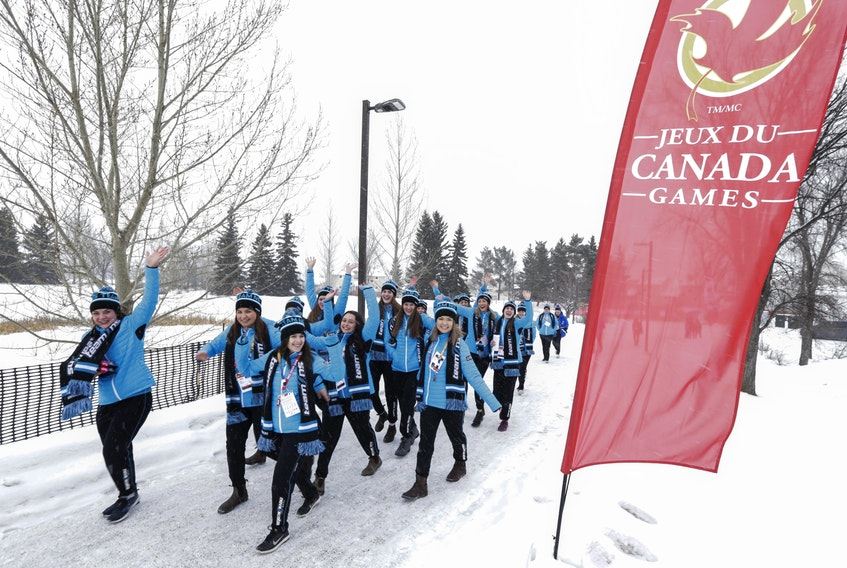 Members of the Nova Scotia ringette team make their way to the Centrium in Red Deer, Alta., for the opening ceremonies Friday at the Canada Winter Games. Competition begins Saturday, with table tennis, speed skating, ringette and boys' hockey scheduled.