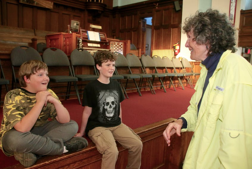 Janet Maybee gives Skylar Nicholson, left, and Ethan Neil tips on their speaking parts in 'Colchester to the Rescue.' The boys will be portraying children who were affected by the Halifax Explosion. LYNN CURWIN/TRURO DAILY NEWS