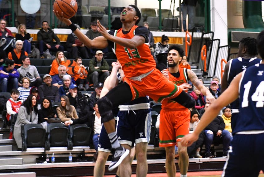 Cape Breton Capers' Chris Hankins flies through the air during Saturday's 117-116 overtime loss to the St. Francis Xavier X-Men in AUS conference men's basketball play at CBU's Sullivan Fieldhouse.