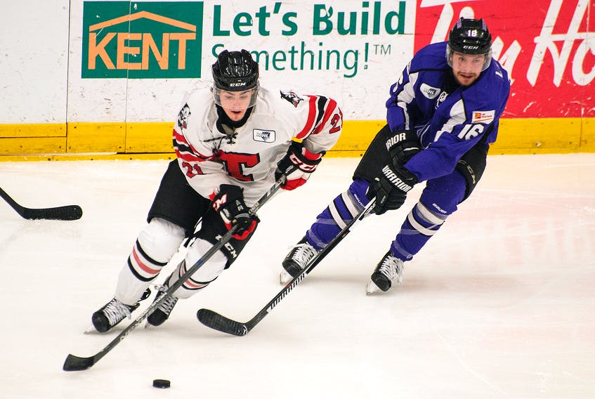 Amherst CIBC Wood Gundy Ramblers forward Felix LeBlanc chances Truro Bearcat Alex MacDonald in Maritime Junior Hockey League action on Friday in Truro. The Bearcats scored three times in the second period en route to a 5-1 win.