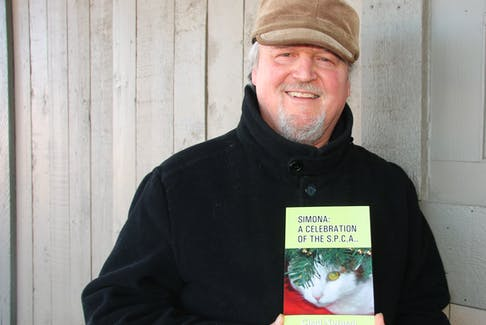 Chad Norman's cat, Simona, was the muse for his newest book of poetry. Sales of the book will help raise funds for the SPCA.