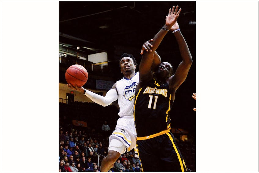 Keith Gosse/The Telegram — Alex Johnson of the St. John's Edge drives to the basket against Bryan Akinkugbe (11) of the London Lightning during NBL Canada action at Mile One Centre Tuesday night. The Edge won 126-123.
