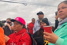 Sipekne'katik Chief Mike Sack (hat and grey sweater) stands with his community members in New Edinburgh, Digby County on Oct. 14, as unrest continued in an ongoing lobster dispute.