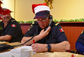 Gerald Coady of the New Waterford Volunteer Fire Department is seen collecting pledges during the annual Combined Christmas Giving Telethon and Auction in New Waterford, Saturday. The local fire department has been helping with the telethon and auction for many years.