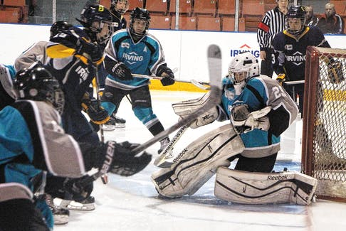 Action from the Irving Oil Challenge Cup Atlantic Canada Bantam Major Hockey Tournament in April of 2015 – a title won by Colten Ellis and his teammates.