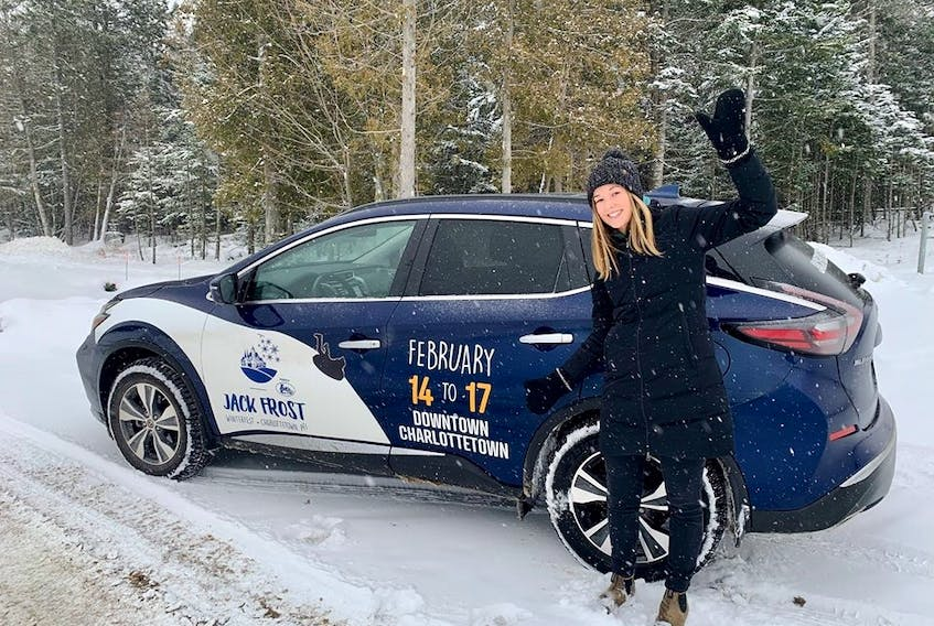 """Tourism and events co-ordinator Charlotte Nicholson is pictured in front of the """"Sno-Rida"""" getting ready for Charlottetown's Jack Frost Festival."""