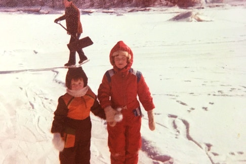 """Stephanie Blades had just shared her love of snow in an email with us when her sister came across this great photo. The sweet picture was taken in 1978; Stephanie was 4 and her sister was 7 years old.  """"That is our beloved late father in the background shovelling off the snow to ensure outdoor fun!"""""""